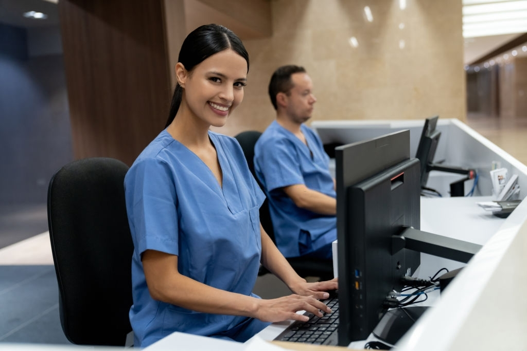 Hospital Administrators working at a hospital and looking at the camera smiling